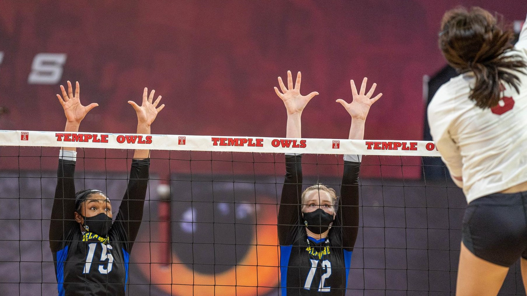 Lauryn Richardson and Grace Underwood go up for a block against Temple