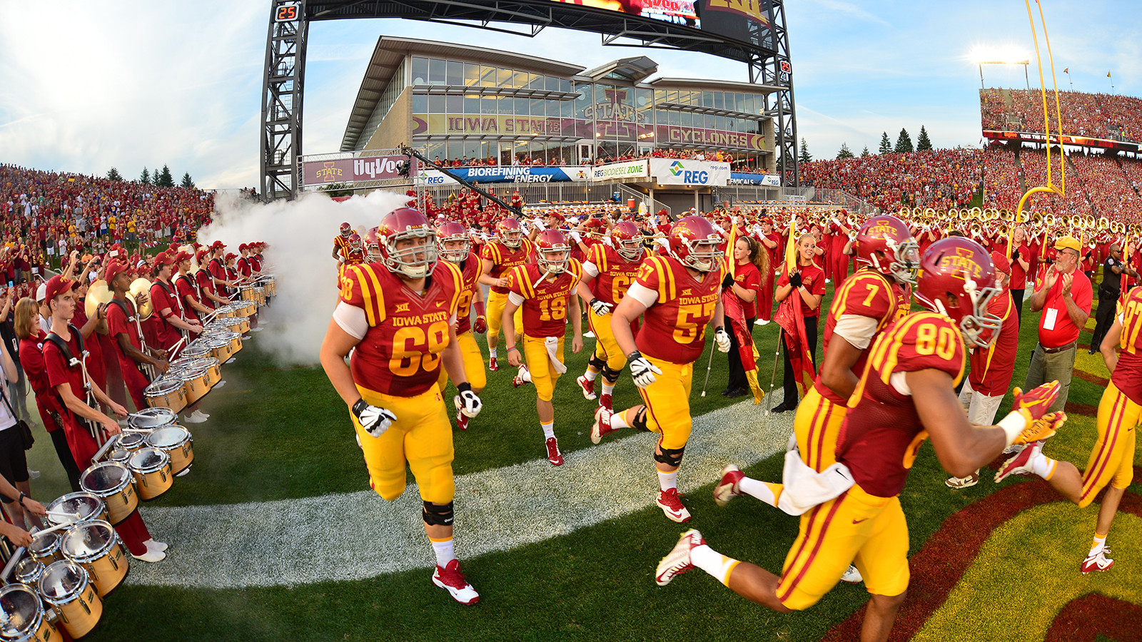 """Iowa State football team taking the field """"pictured here"""""""
