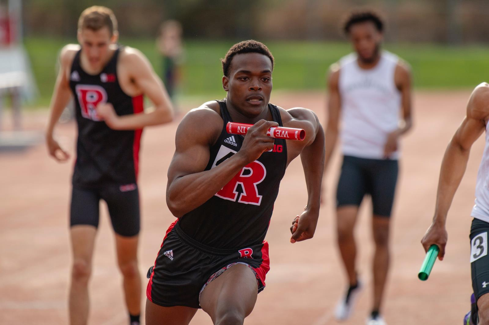The Rutgers track and field team members running