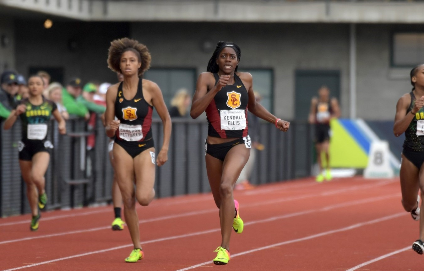 Two USC Trojans running in a track and field tournament